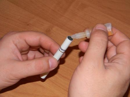 Заправка сигареты жидкостью