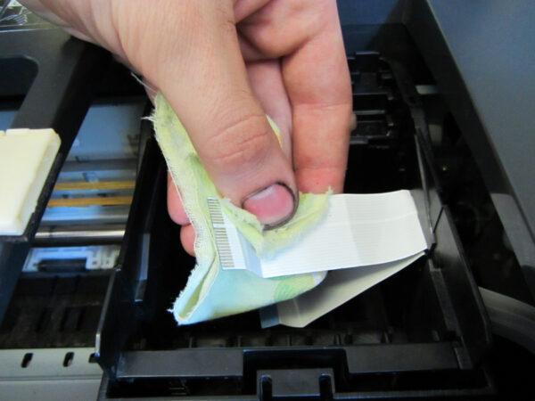 Удаление остатков жидкости с принтера